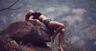 Beautiful girl on rock